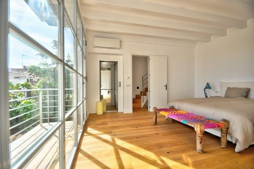 Comfortable double bedroom with balcony and a lift