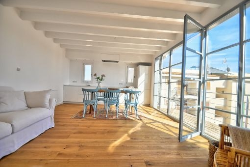 Very light-flooded living and dining area on the upper floor