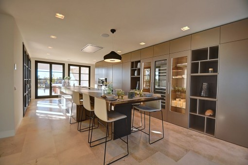 Generous and stylish kitchen with cooking island and dining area