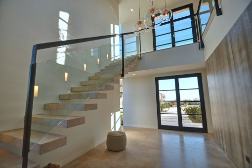 A staircase leads to the gallery on the upper floor