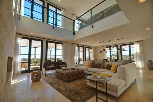 Spacious living and dining area with a wide gallery