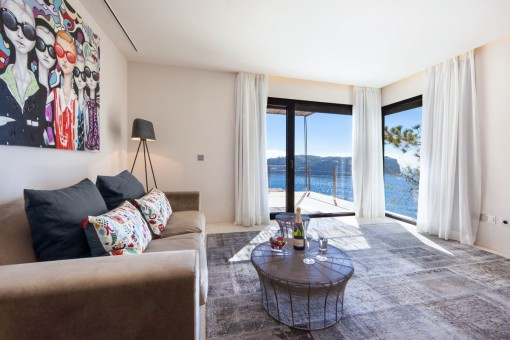 The bedroom offers a lounge area with superb views
