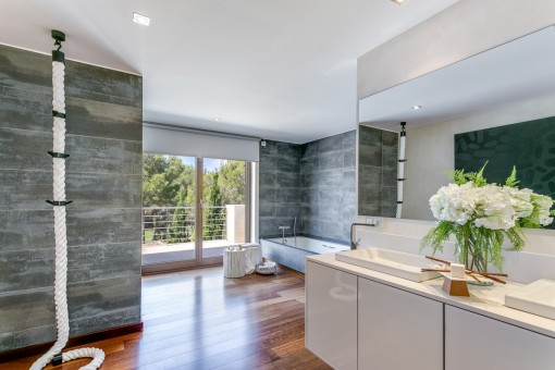 The bathroom offers access to the balcony