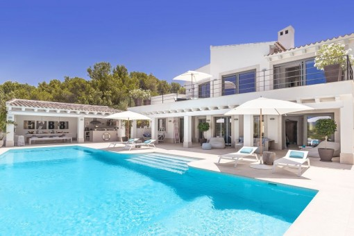 Impressive villa with seating area beside the pool