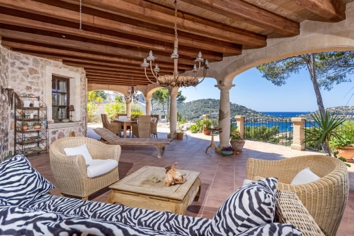 Covered terrace with lounge area and fantastic sea views