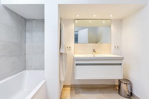 Master bathroom with bath tub