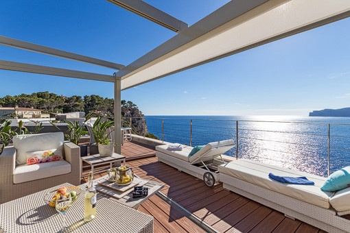 Sunny terrace with lounge area and sea views