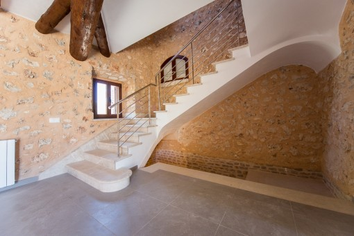 Staircase leads to the upper floor