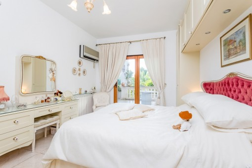 Elegant master bedroom with access to terrace