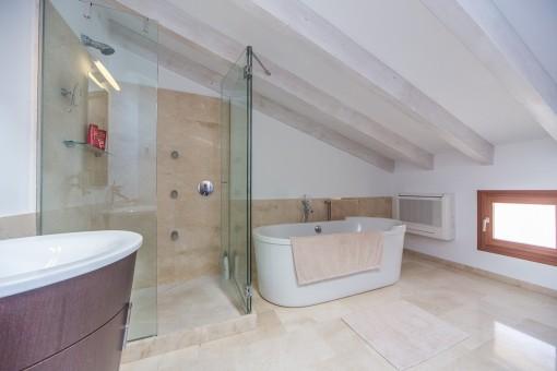 Master bathroom with bath tub and shower