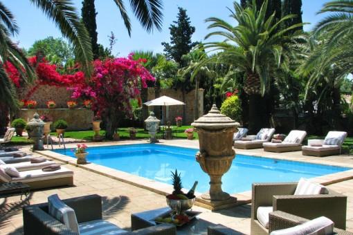 Deamlike pool area with sunloungers