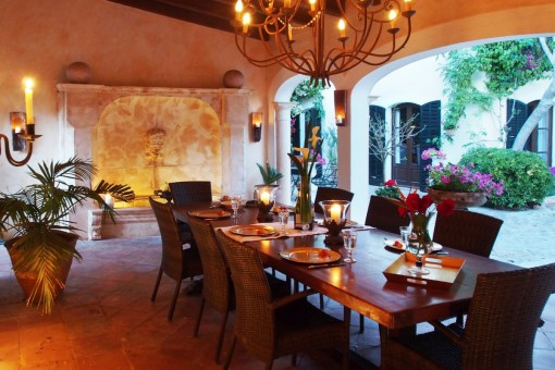 Large dining table under the covered terrace