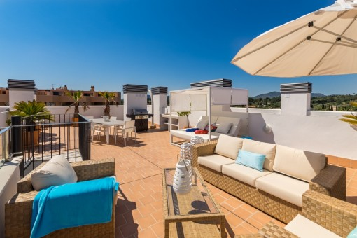 Inviting lounge area on the spacious roof terrace