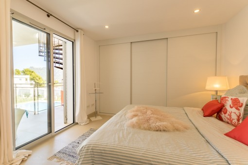 Bright master bedroom with access to terrace