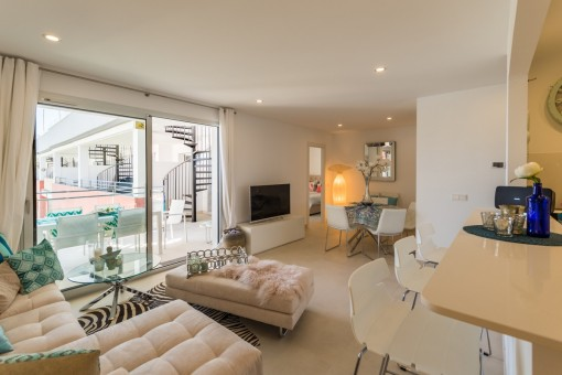 Tastefully furnished living area with access to the balcony