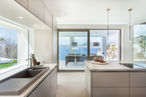 The kitchen offers direct access to the terrace