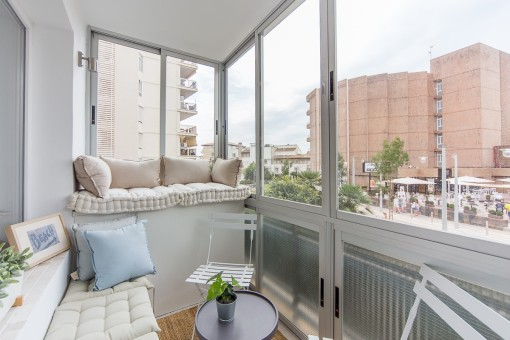 Lounge area on the balcony with views of the surrounding