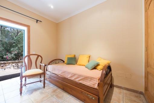Guest bedroom with garden views