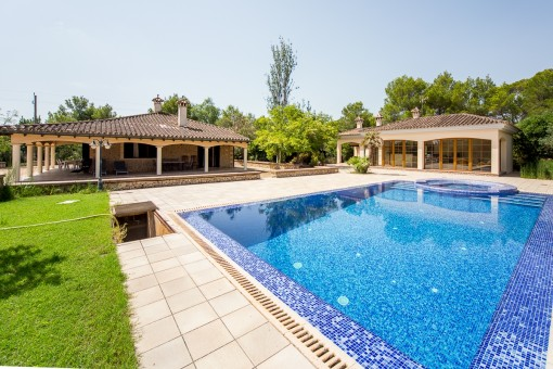 Pool is surrounded by a a terrace