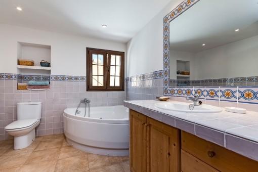 Bathroom with bathtub and nautral light