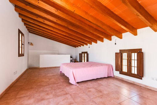 The wooden beam ceilings are typical for this town house