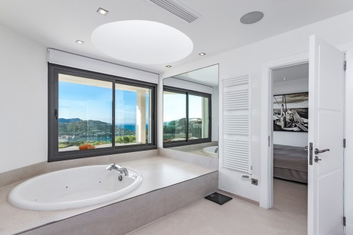 Master bathroom with bathub and sea views