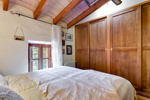 Bedroom with wood-beamed ceiling