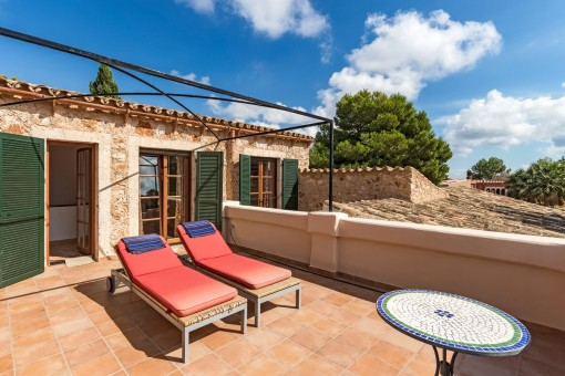 Sunny terrace with sunloungers