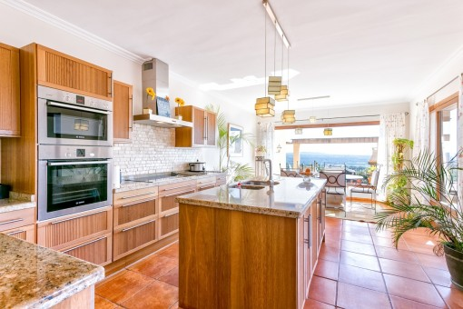 Elegant kitchen with cooking island and panorama windows