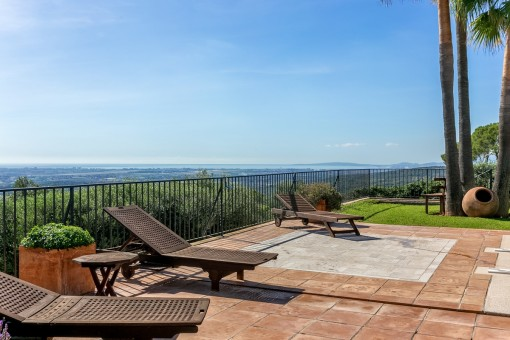 Sun terrace with sun loungers and superb views