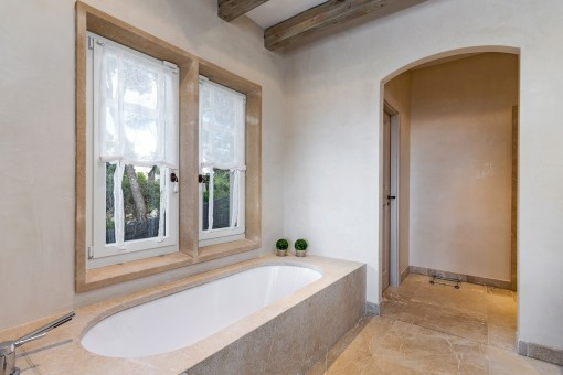 Master bathroom with bathtub
