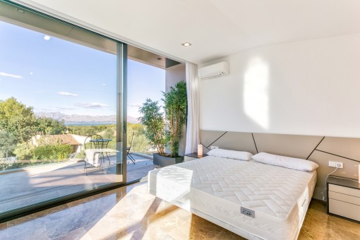 Master bedroom on the first floor with own balcony