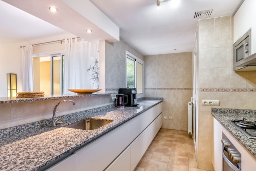 Fully equipped kitchen with serving hatch