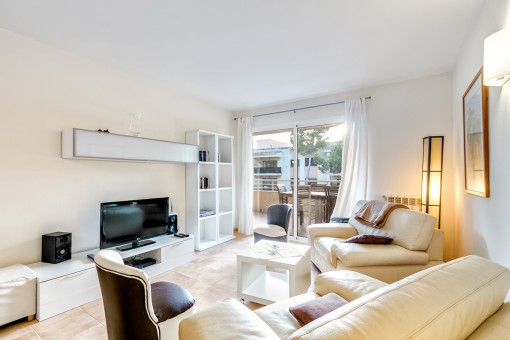 Bright living area with balcony access