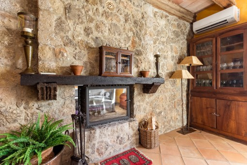 Doubled-sided fireplace integrated into the natural stone wall