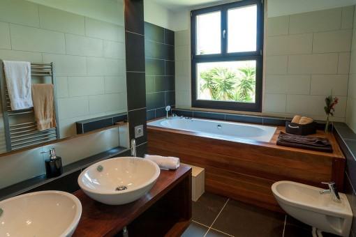Stylish bathroom with bathtub for colder days