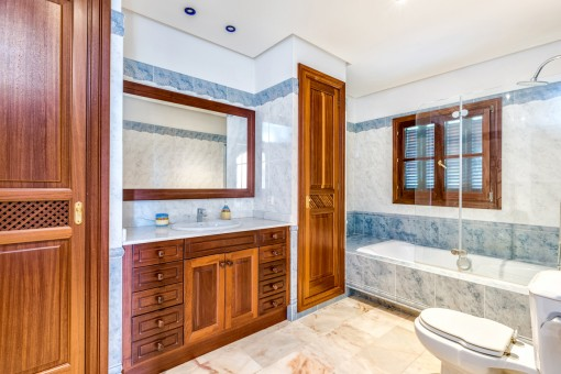 Bathroom with built-in wardrobes and natural light