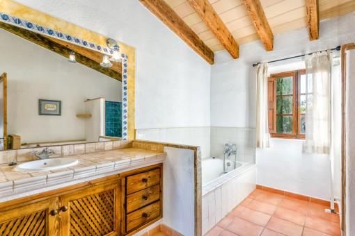 En-suite bathroom with bathtub