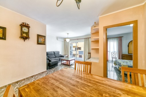 Views from the dining area to the bright living area with terrace access