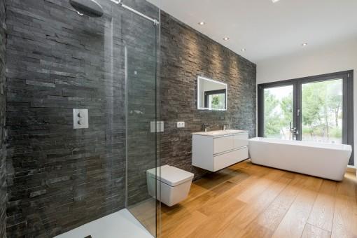 Spacious bathroom with bathtub and shower