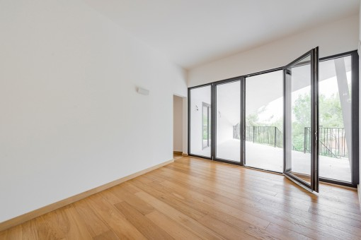 Spacious office or bedroom with panoramic window