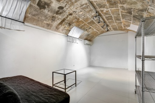 Large room with a vaulted ceiling