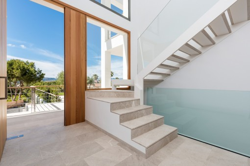 An elegant staircase leads to the upper floor