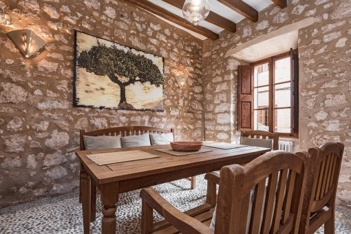 Dining area with natural stone wall
