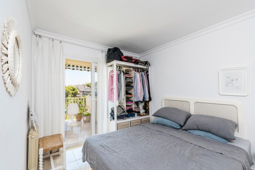 Bright double bedroom with terrace access