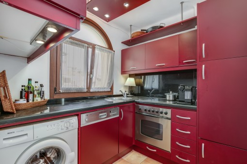 Fully equipped kitchen in red