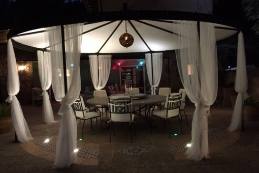 Outdoor dining area by night