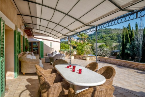 Sunny dining area and lounge on the terrace