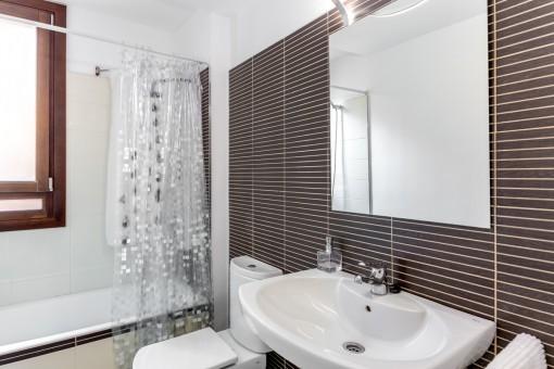 Charming bathroom with bathtub